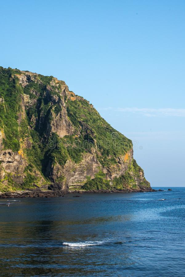JEJU ISLAND, KOREA: View of Seongsan Ilchulbong Volcanic Cone from the town at the foothill. royalty free stock photography