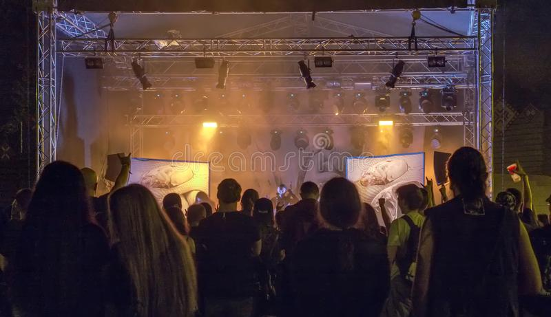 Heavy metal fans enjoying live gig royalty free stock photo