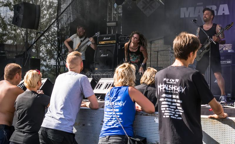Heavy metal fans enjoying the live performance of Latvian metal band Māra royalty free stock photography