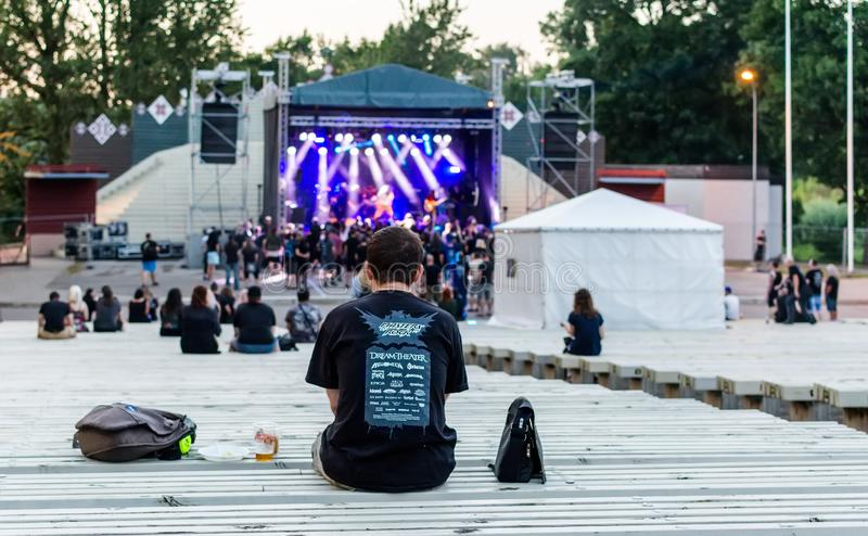 Heavy metal fans looking at stage at Metalshow Open Air festival in Latvi royalty free stock image