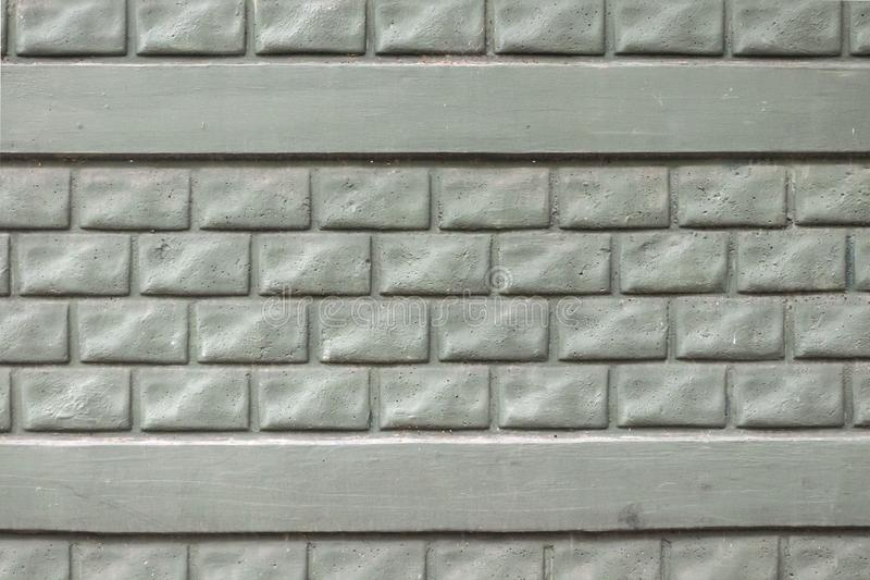 Brick wall. The brick wall painted in green. Jellied painted brick fence. Background stock photo