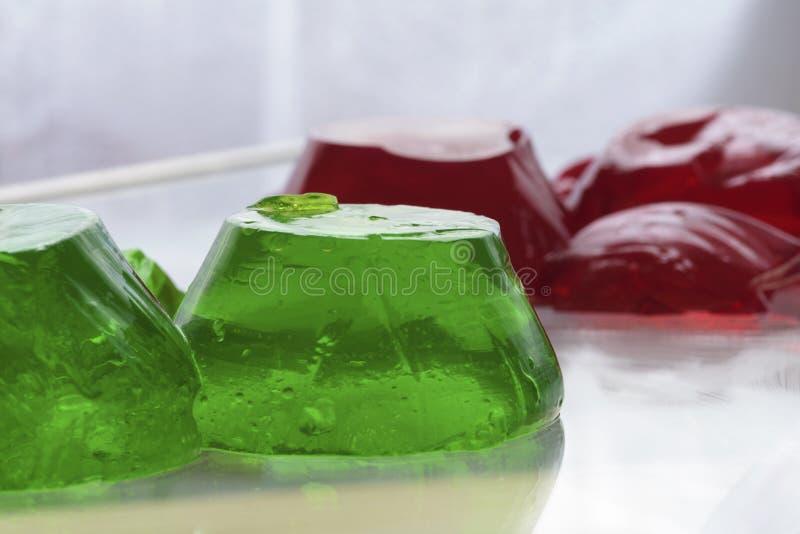 Jello in groen en rood stock afbeelding