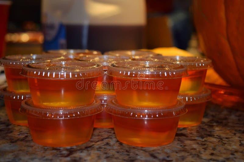 Jello shots in cups stock photos