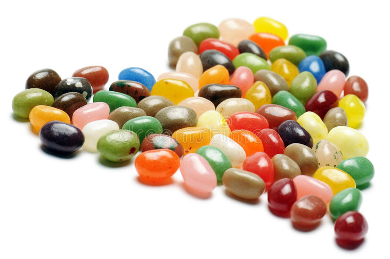 Jelly beans. Fruit jelly beans, heart-shaped on white background royalty free stock image