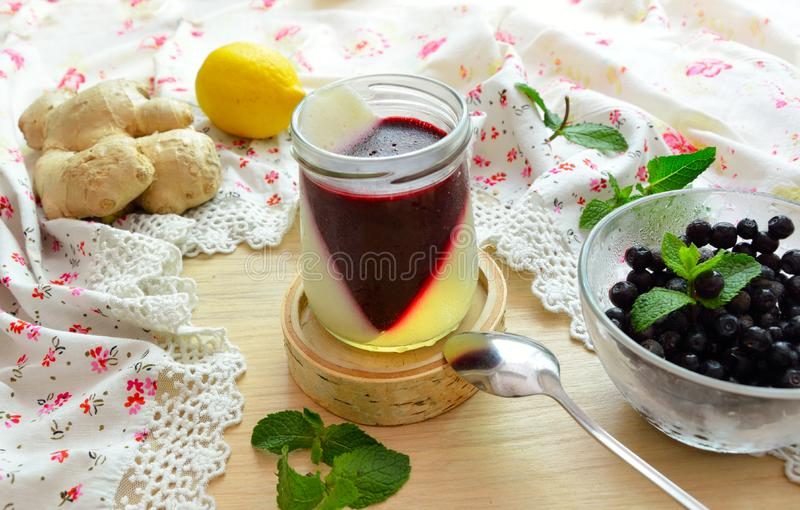 Jelly with berries, ginger and a lemon stock photo