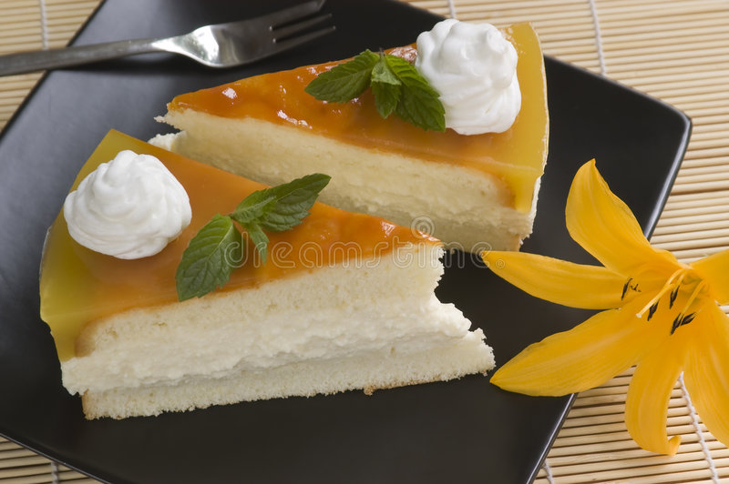 Jelly cake. Slice cake with whipped cream and with flower royalty free stock photo