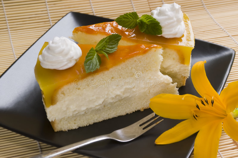 Jelly cake. Slice cake with whipped cream and with flower stock image