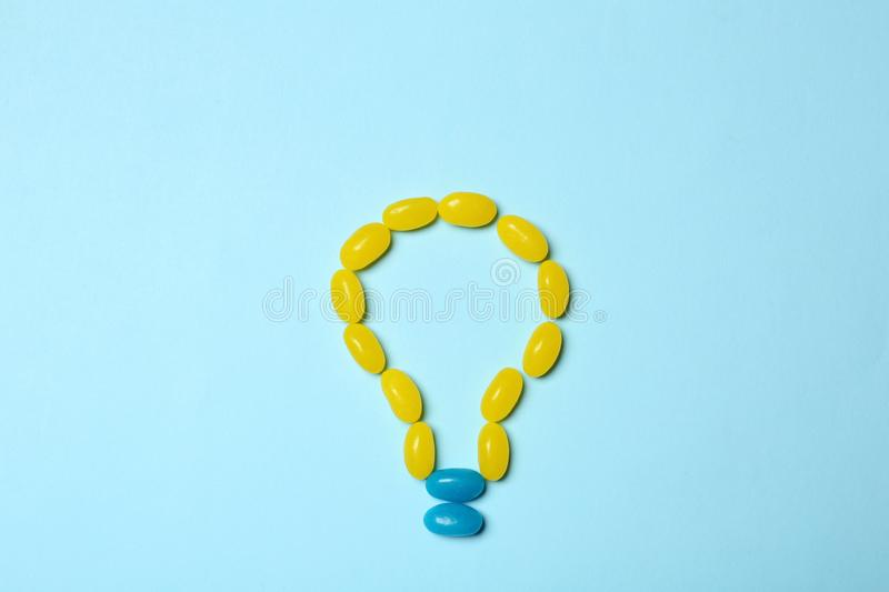 Jelly candies arranged as lamp, flat lay. Creative idea. Jelly candies arranged as lamp on color background, flat lay. Creative idea stock photography