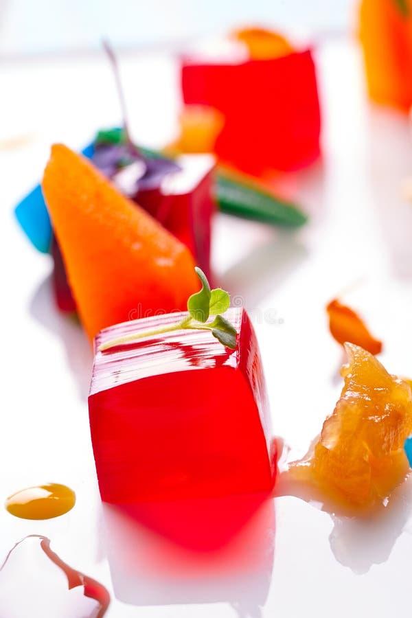 Jelly colorful fruits gelatine on white. Background stock photo