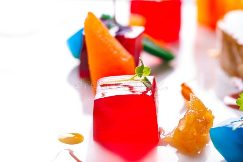 Jelly colorful fruits gelatine on white. Background stock photos