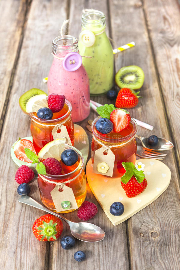 Jelly and fruit smoothie. Healthy summer treat. stock photos