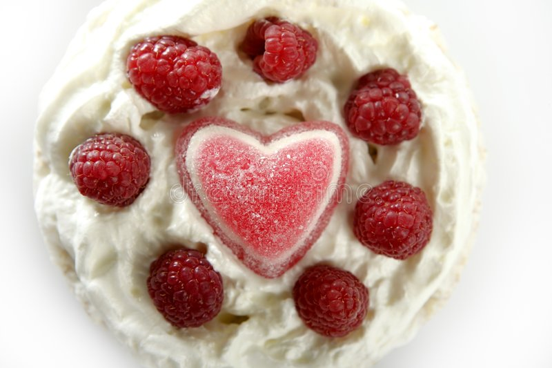 Jelly hearth cream cake with raspberries. Valentines day royalty free stock photo