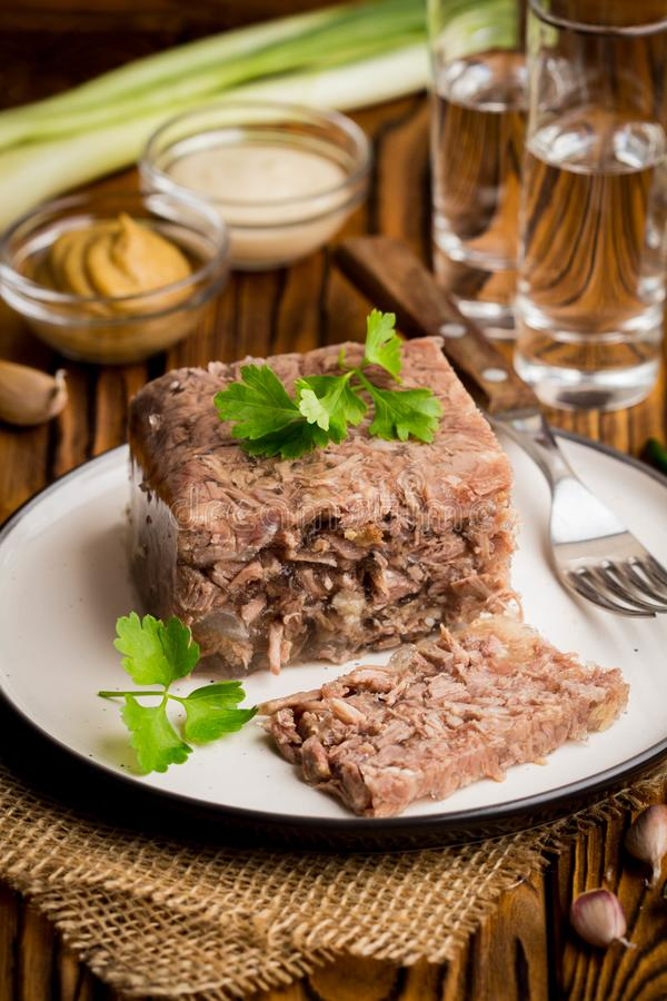 Jelly with meat, beef aspic, traditional Russian dish, portion stock images