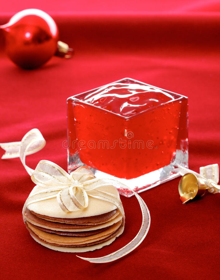 Tuiles biscuits tied with ribbon isolated on red. Clean and eatable jelly and crispy tuiles biscuits display on red background royalty free stock image