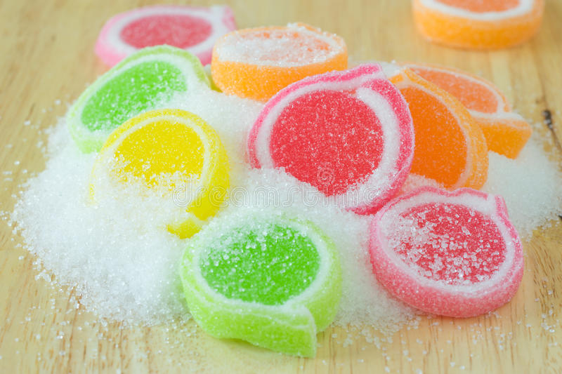 Jelly sweet, flavor fruit, candy dessert colorful on wood background. royalty free stock photo