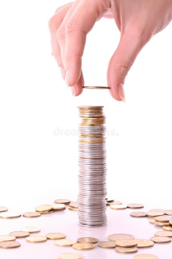 Jemand fügen Münze hinzu lizenzfreies stockbild