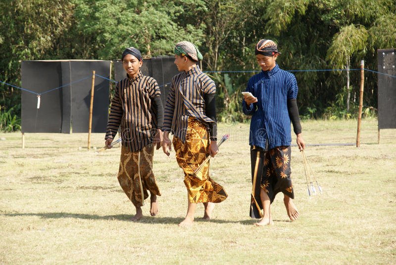 Jemparingan is the art of traditional Mataram style archery in Yogyakarta, Indonesia. Some youth preservers of the `jemparingan` tradition are taking arrows royalty free stock image
