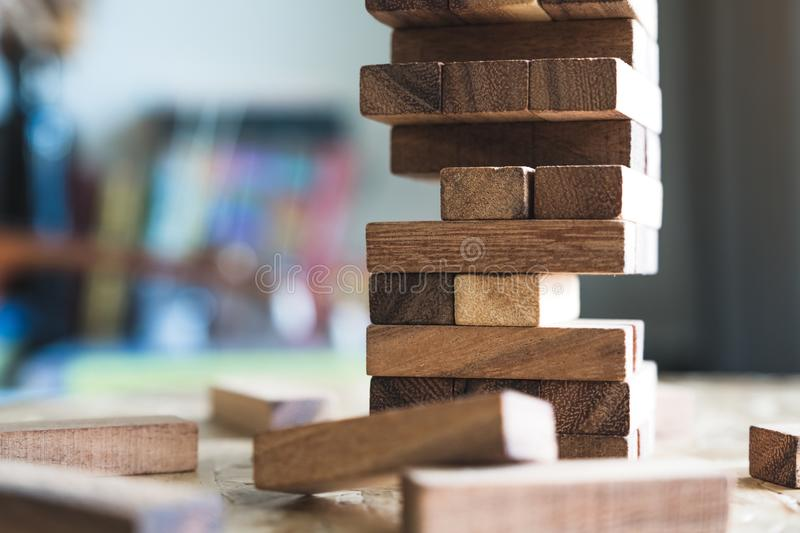 A Jenga or Tumble tower wooden block game. Closeup image of a Jenga or Tumble tower wooden block game royalty free stock photography