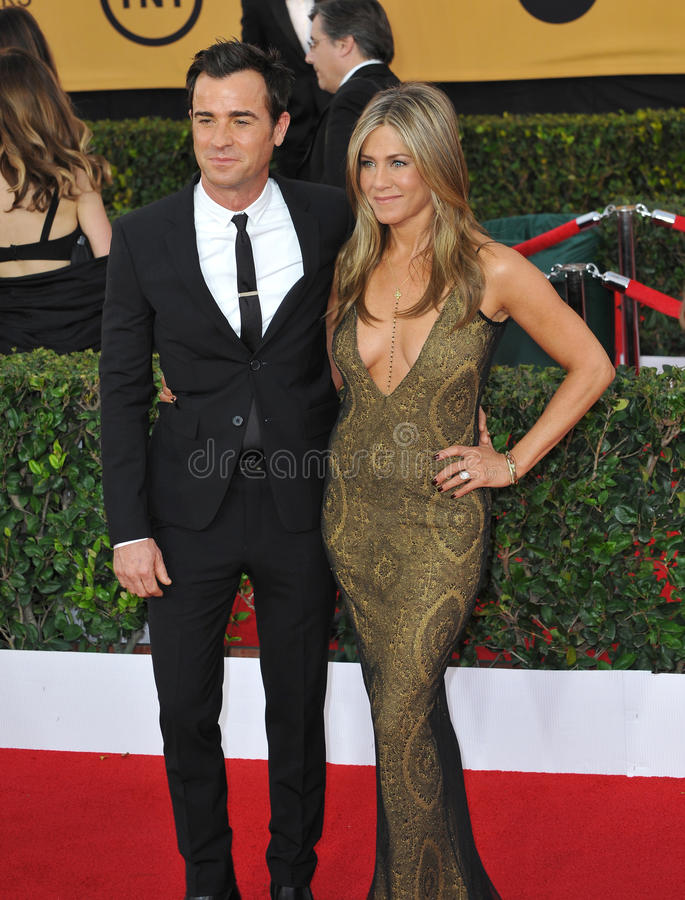 Jennifer Aniston & Justin Theroux. LOS ANGELES, CA - JANUARY 25, 2015: Jennifer Aniston & Justin Theroux at the 2015 Screen Actors Guild Awards at the Shrine royalty free stock photo