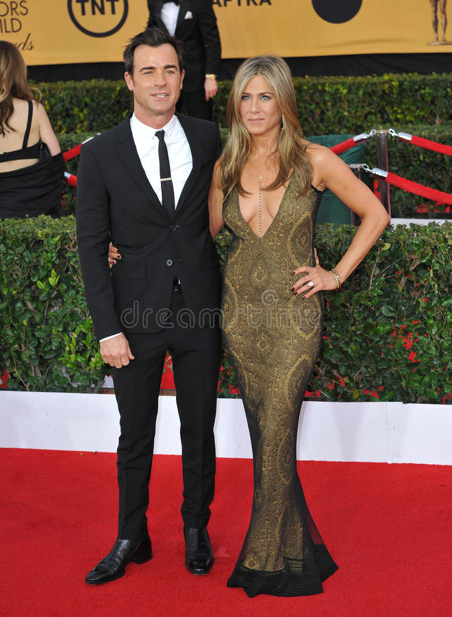 Jennifer Aniston & Justin Theroux. LOS ANGELES, CA - JANUARY 25, 2015: Jennifer Aniston & Justin Theroux at the 2015 Screen Actors Guild Awards at the Shrine stock photo