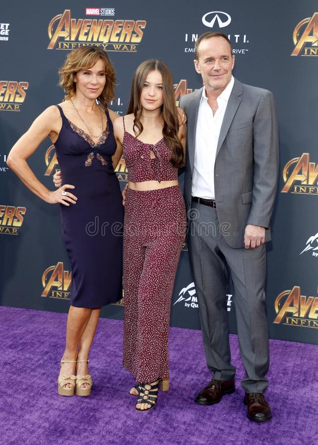 Jennifer Grey, Clark Gregg and Stella Gregg. At the premiere of Disney and Marvel`s `Avengers: Infinity War` held at the El Capitan Theatre in Hollywood, USA on stock photos