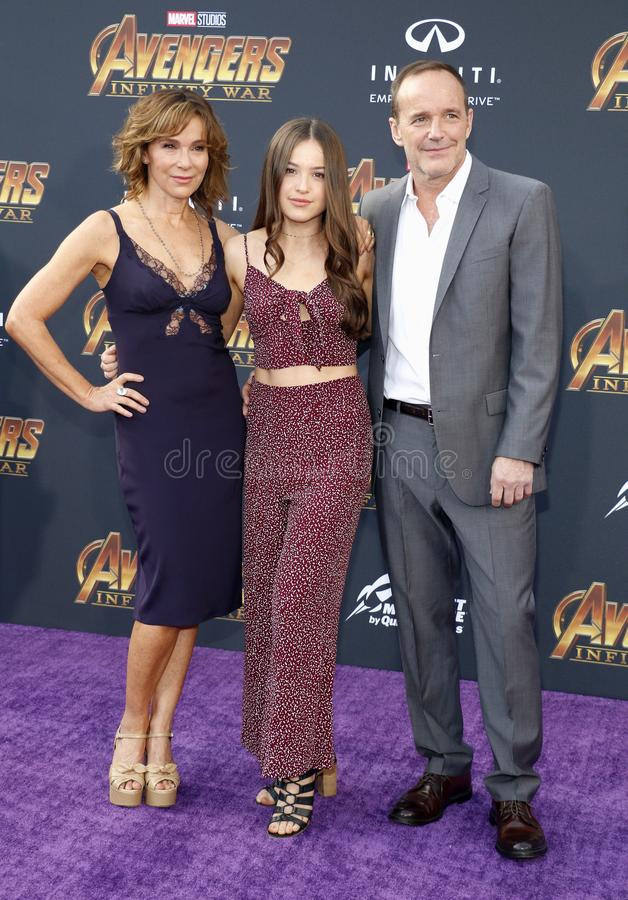 Jennifer Grey, Clark Gregg and Stella Gregg. At the premiere of Disney and Marvel`s `Avengers: Infinity War` held at the El Capitan Theatre in Hollywood, USA on royalty free stock image