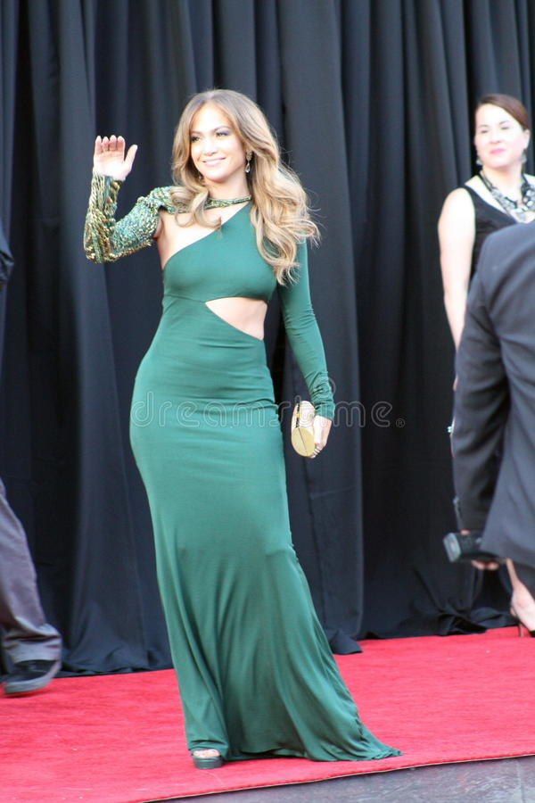 Jennifer Lopez. Jennifer waving to waiting fans at the reception for William and Kate stock photography