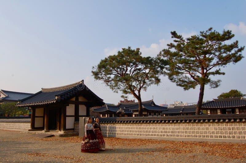 Jeonju Hanok Village, South Korea - 09.11.2018: Womans in hanbok dress inside of traditional palace. royalty free stock photo
