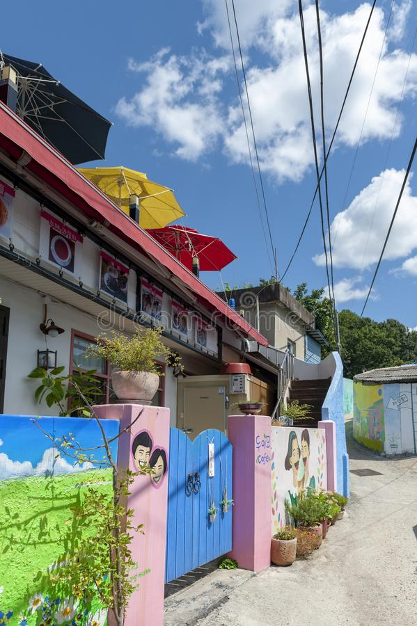 Colourful paintings and decorations on walls and buildings at Jaman Mural Village in Jeonju, South Korea stock photos