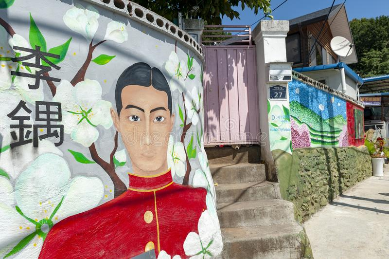 Colourful paintings and decorations on walls and buildings at Jaman Mural Village in Jeonju, South Korea royalty free stock photo