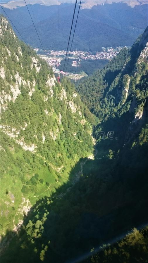 Jepii Mici Valley, Romania. Picture taken from the cable cabin climbing towards Caraiman cabin at 2000 meters royalty free stock photo