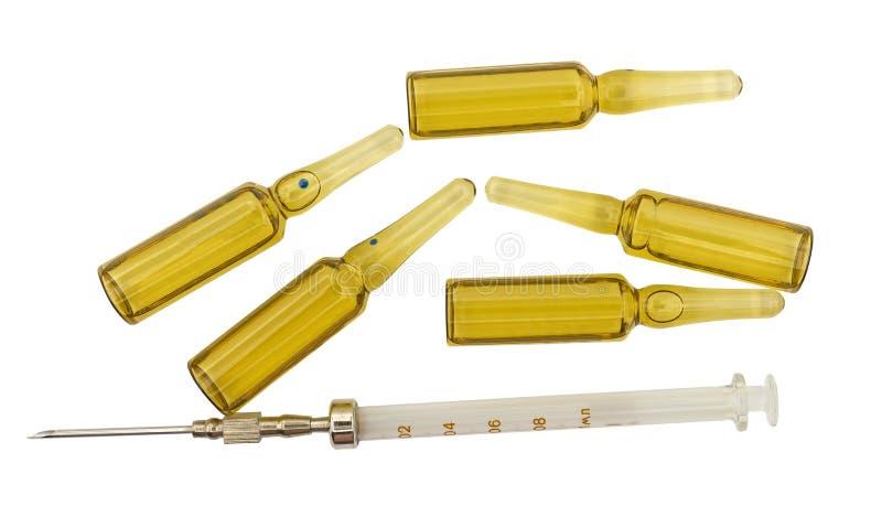 Jeringuilla con la aguja y las ampollas fotografía de archivo libre de regalías