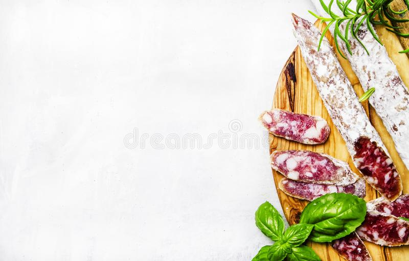 Jerked spanish sausages from pork with basil and rosemary, top v stock images