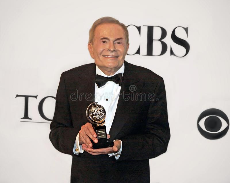 Jerry Hermann. Broadway powerhouse Jerry Hermann, a Tony-winning composer and lyricist holds his statuette for Lifetime Achievement in the Theater, presented at stock image