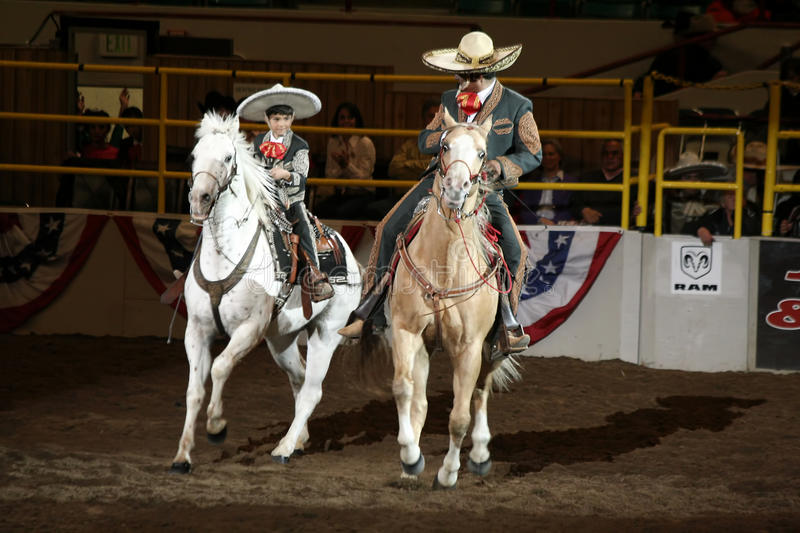 Jerry and Nicolas Diaz. Jerry Diaz and his son Nicolas perform at the National Western Stock Show in Denver, Colorado. Jerry Diaz is a fourth-generation champion royalty free stock photos