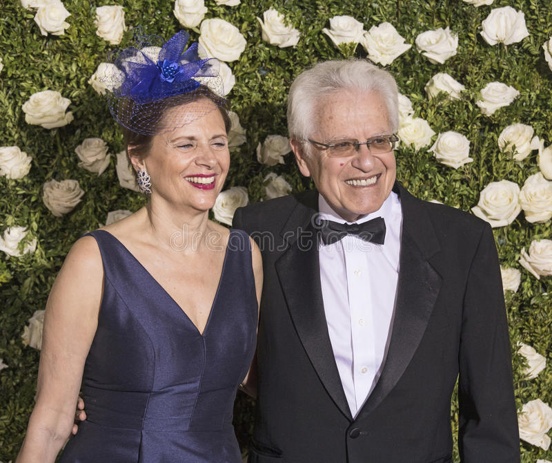 Jerry Zaks and Jill Rose. Veteran director and previous Tony winner Jerry Zaks is all smiles as he arrives with wife Jill Rose for the 71st Annual Tony Awards at royalty free stock photography