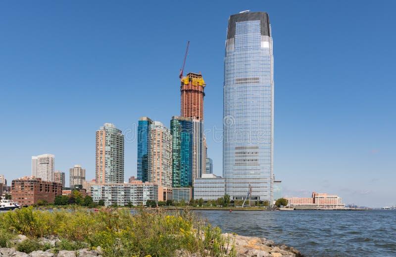 Jersey City horisont längs Hudson River arkivfoto