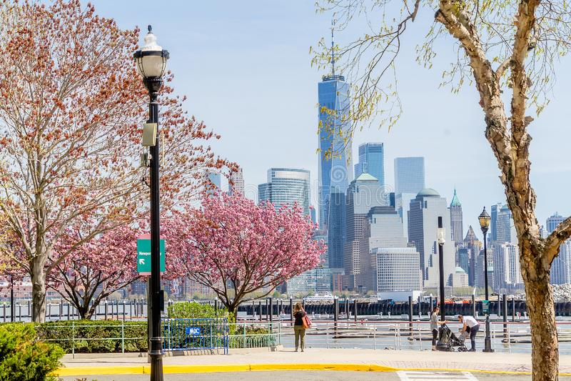 JERSEY CITY, NEW JERSEY, USA - MARCH 22, 2018: Downtown view of Manhattan taken fron New Jersey side over the Hudson River royalty free stock photos
