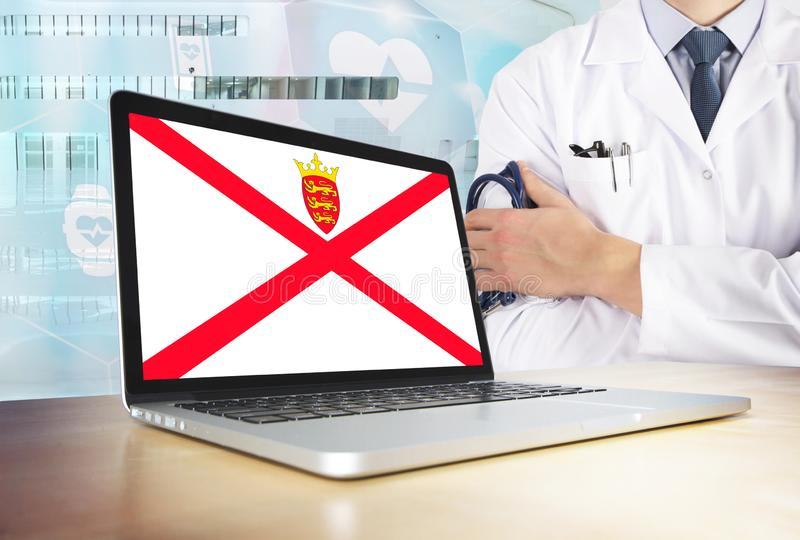 Jersey healthcare system in tech theme. Flag on computer screen. Doctor standing with stethoscope in hospital. Cryptocurrency and. Blockchain concept stock image