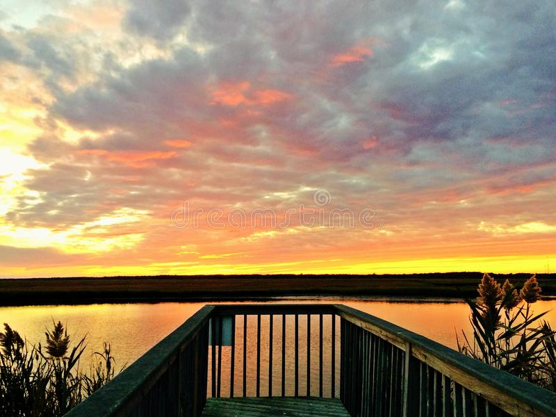 Jersey-Ufer-Sonnenuntergang lizenzfreie stockbilder