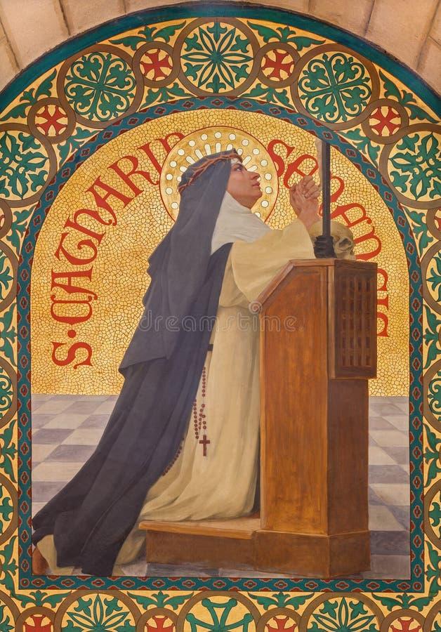 Jerusalén - la pintura del santo Catharine de Siena en iglesia del st Stephens a partir del año 1900 de Joseph Aubert imagenes de archivo