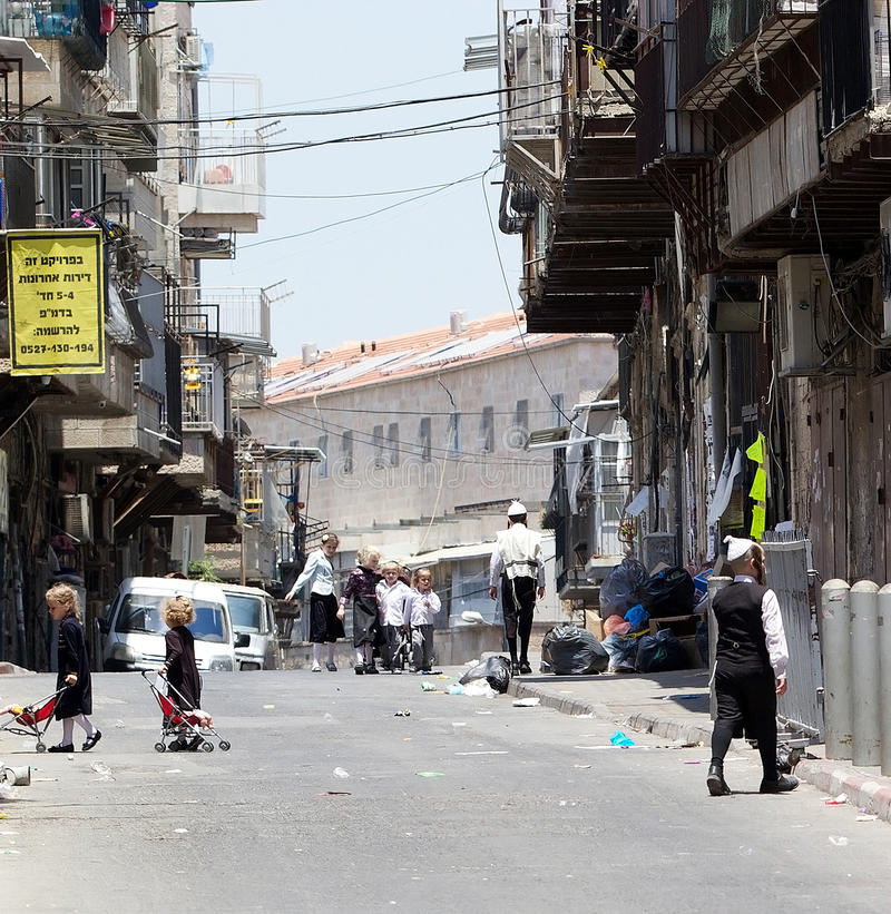 Jerusalem. Children in traditional dress are walking in the street at Mea She'Arim, the jewish orthodox district in Jerusaelm, Israel royalty free stock photos
