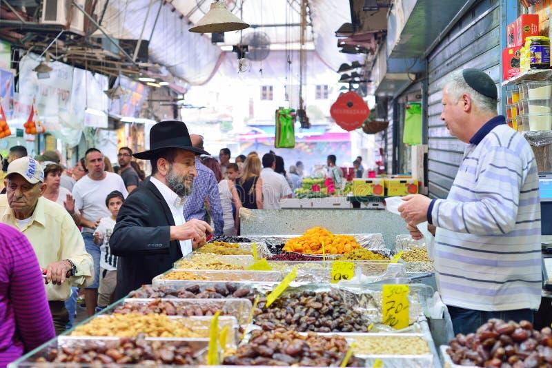 JERUSALEM, ISRAEL - APRIL 2017: Market sketch, Israeli trade, seller and buyer in Israely Market Mahane Yehuda, Jerusalem.  royalty free stock photography