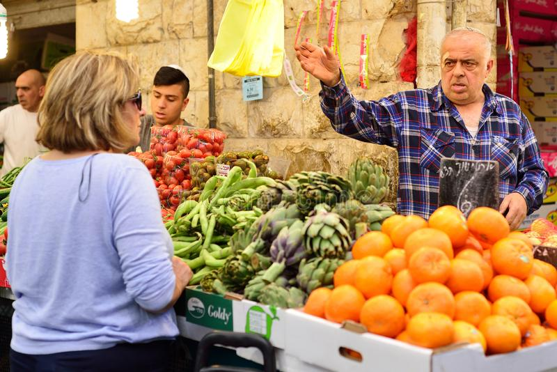 JERUSALEM, ISRAEL - APRIL 2017: Market sketch, Israeli trade, seller and buyer in Israely Market Mahane Yehuda, Jerusalem.  stock image