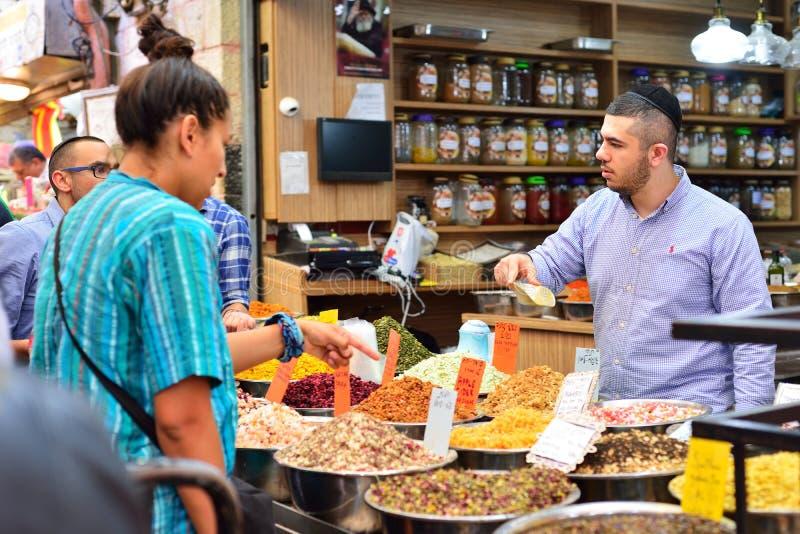 JERUSALEM, ISRAEL - APRIL 2017: Market sketch, Israeli trade, seller and buyer in Israely Market Mahane Yehuda, Jerusalem.  stock photos