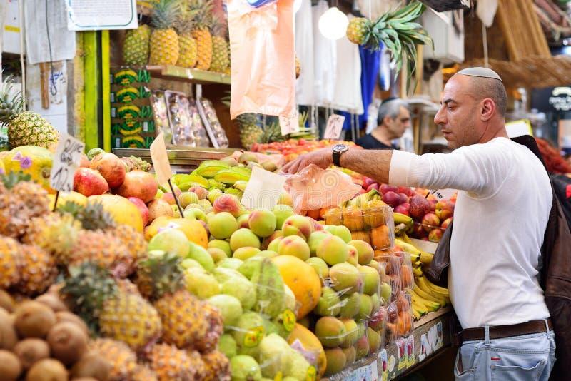 JERUSALEM, ISRAEL - APRIL 2017: Market sketch, Israeli trade, seller in Israely Market Mahane Yehuda, Jerusalem.  stock photos