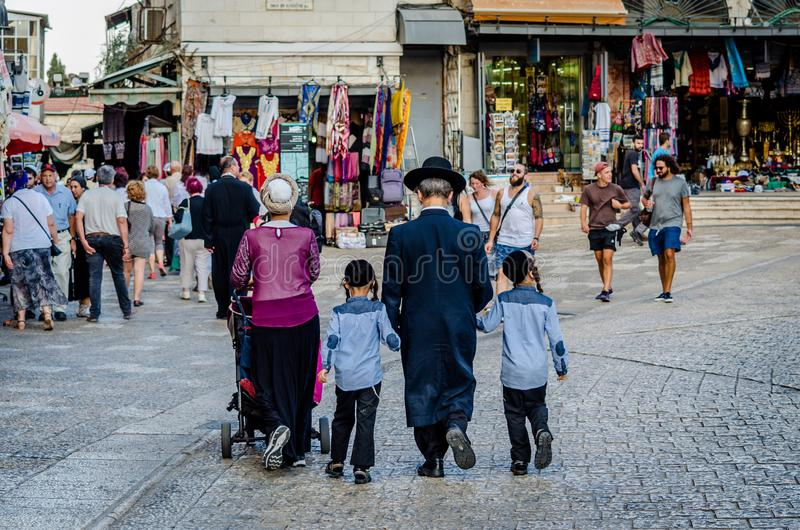 Jerusalem/Israel- August 17, 2016: Orthodox Jewish family at Jaffa Gate in Jerusalem, Israel. Jerusalem/Israel- August 17, 2016: Orthodox Jewish family walking royalty free stock photos