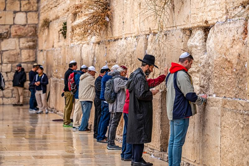 11/23/2018 Jerusalem, Israel, Believing Jews is praying near the wall of crying. Under the rain stock image