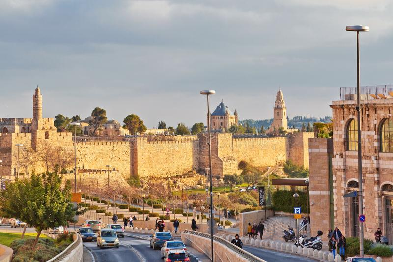 Road traffic along the wall of the old city of Jerusalem royalty free stock photography