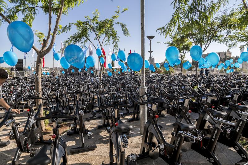 Cycling equipment and blue ballons on a public fitness event in. Jerusalem, Israel - June 14, 2018: Cycling equipment and blue ballons on a public fitness event stock photos